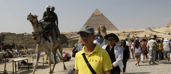 Tourists visit the Pyramids of Giza in Cairo